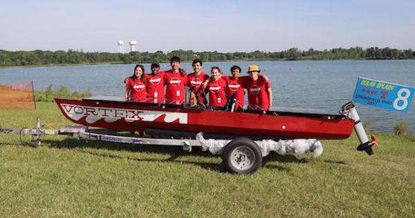 "CMU Solar Racing team poses behind red boat ""Vortex"" at SOLAR SPLASH"