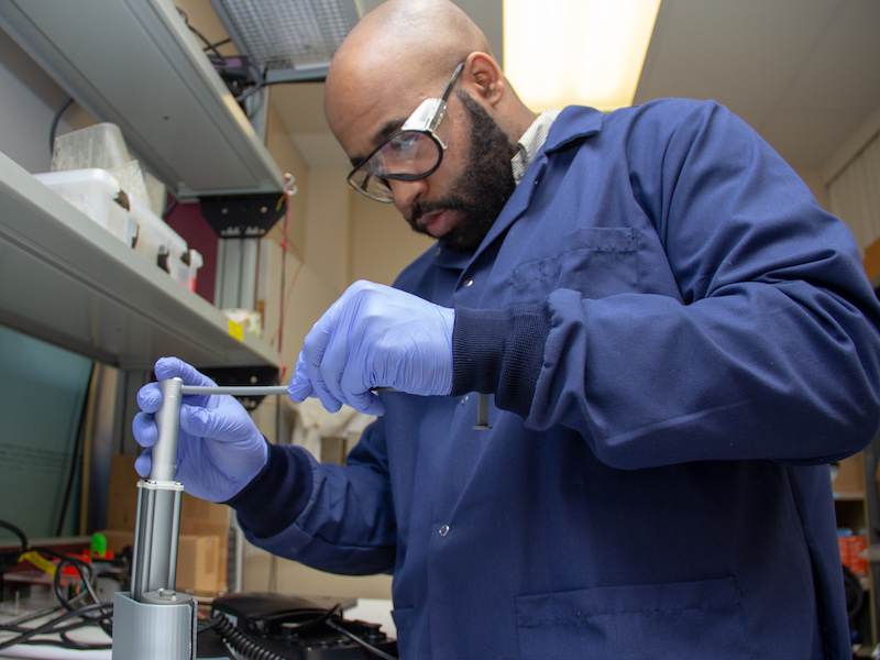Ph.D. student Justin Bobo in the lab.