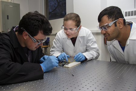 Professor Bergbreiter in the lab with students.