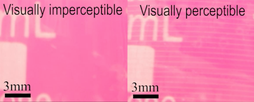 The sensor on the camera lens appear completely clear on the left side, but has visible stripes on the right side.