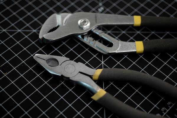 a photo of pliers on a graphed surface